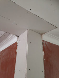 Before picture of a crown molding plaster repair